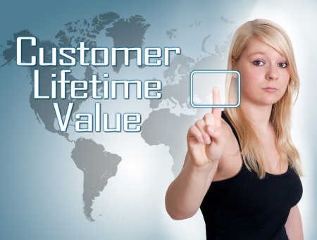 25033534 - young woman press digital customer lifetime value button on interface in front of her